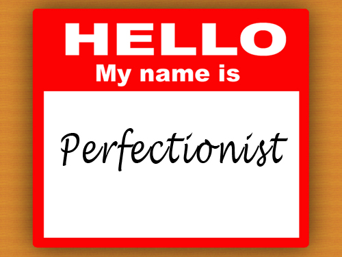 Name tag with Perfectionist on it.